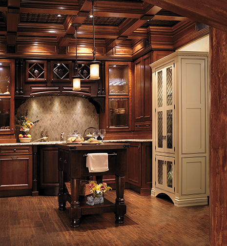 Formal kitchens often display a room with all of the bells and whistles. The details such as the island legs, decorative glass doors, and coffered ceiling make this kitchen a formal masterpiece.