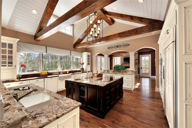 The architectural and top to bottom details are crucial to the design of this kitchen. From the beams and archways to the mullion cabinet doors and island legs, this kitchen portrays every aspect of traditional.